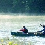 Mist on the river and canoes