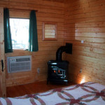 Queen bedroom with stove