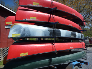trailer of canoes