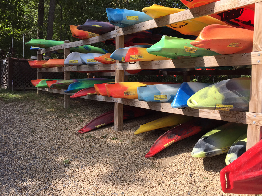 Rack of rental kayaks